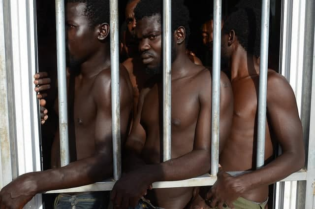 Migrants locked up in a camp in Libya.