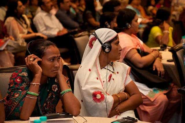Vandana Devi and Gulabi Bahadur, two elected women representatives from Jhabua district in Madhya Pradesh listen to UN Women Executive Director Michelle Bachelet speak during the National Leadership Summit in Jaipur, India on 4 October 2012.