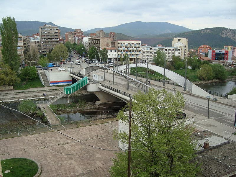 The Mitrovica Bridge in North Kosovo is an iconic symbol of Kosovo's division. South of the Ibar River live Albanian Kosovars, while the land north of the Ibar is occupied by Serbian communities.