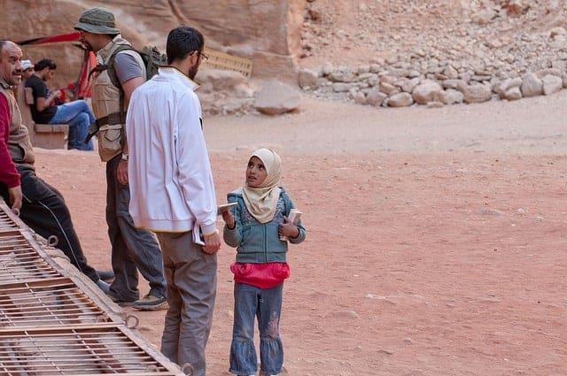 Children selling postcards in Petra, Jordan.