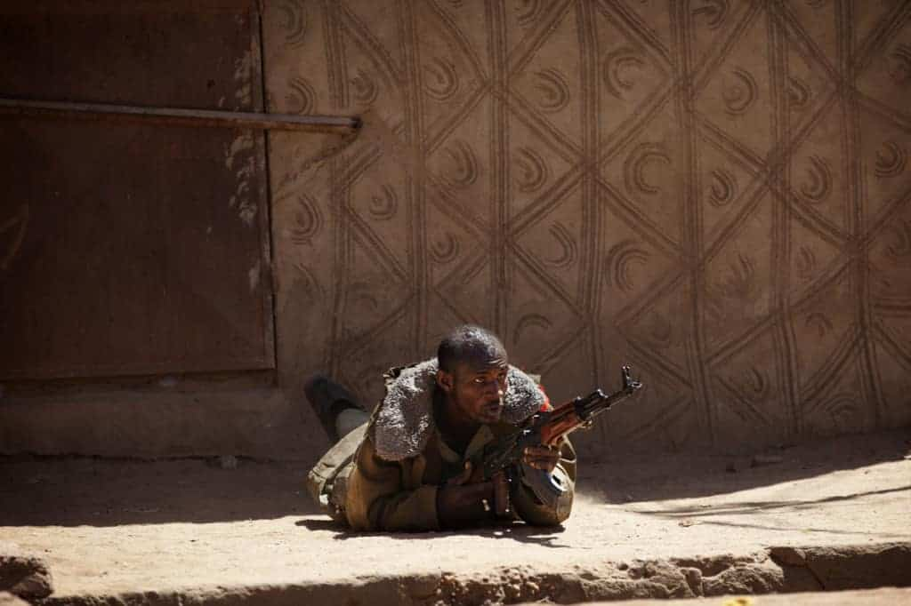 A Malian soldier fires an AK-47 during fighting with Islamists in Gao