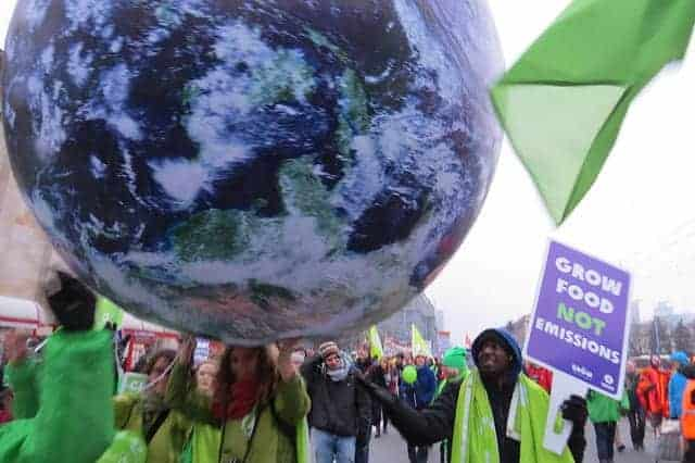 Oxfam protesters, climate change conference, Warsaw