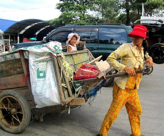 Cambodian woman pulling a cart.