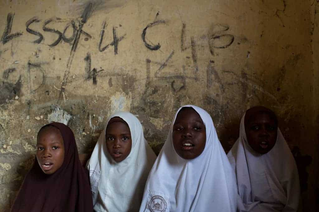 Girls reciting Quranic verses at an Islamic school in Maiduguri, Nigeria. JOE PENNEY