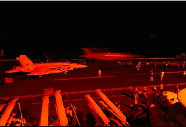 US Navy Super Hornets prepare to launch from USS George H.W. Bush in the Arabian Gulf, to conduct strikes against the terrorist group ISIS in Syria, Sept. 22, 2014. ROBERT BURCK/US NAVY
