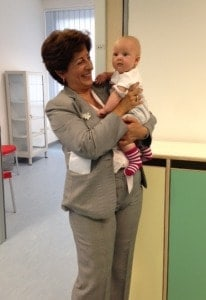 Theresa Panuccio, the author and tktk of the Food and Agriculture Organization, in Rome, with Mia, a participant in the agency's on-site child-care center.