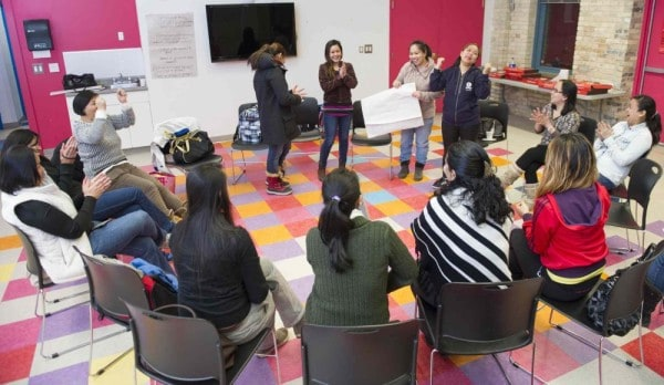 Through associations and nonprofit groups that help immigrants cope with some of the emotionally overwhelming changes they encounter in their new country, Canada, assimiliation is easier. DAVID LIPNOWSKI/WINNIPEG FREE PRESS