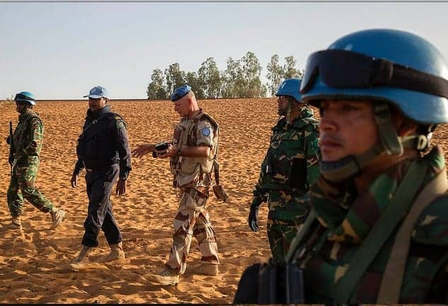 A contingent of peacekeepers from Niger and Bangladesh on patrol in Ansongo, northern Mali. MARCO DORMINO/MINUSMA
