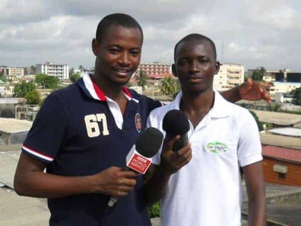 Essan Emile Ako with a fellow Ivoirian, a journalist with BBC in Abidjan.