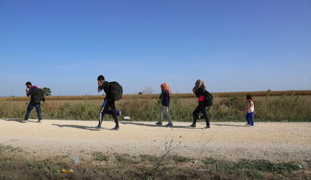 Syrians walking along the Serbian-Croatian border amid the influx of 2015. FRANCESCO MALAVOLTA/IOM