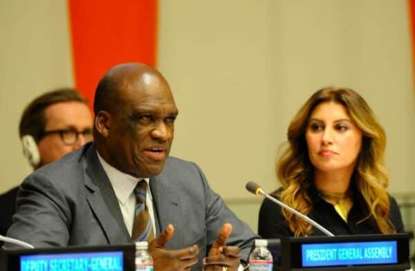 John Ashe, left, a former president of the United Nations General Assembly, has been indicted for tax fraud in a bribery scheme. Afaf Konja, right, was his spokeswoman. They appear at a UN event in February 2014.