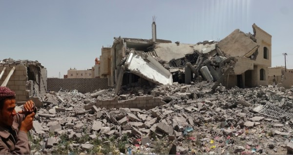 A destroyed home in Sana, the capital of Yemen. Both the Saudi-led coalition and the Houthis rebels have been accused of war crimes. IBRAHEM QASIM