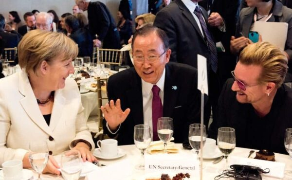 At a luncheon to promote the new global goals, people from the private sector mingled with heads of state. Here, Angela Merkel of Germany, Ban Ki-moon of the UN, and Bono, the singer. KIM HAUGHTON/UN PHOTO