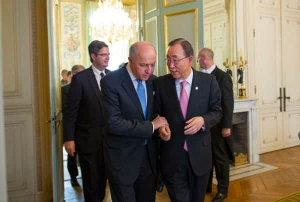 Laurent Fabius, France's foreign minister, left, and Ban Ki-moon, UN secretary-general at the UN's conference on climate change,