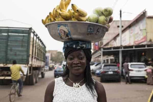A banana and apple soba, or owner, selling her goods on the streets of Ouagadougou, the capital of Burkina Faso, in West Africa. NABILA EL HADAD