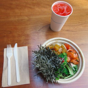 A strawberry lemonade accompanies a poké bowl topped with salmon, golden beets and a heap of nori seaweed. IRWIN ARIEFF